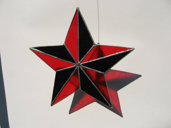 The Red Point Star Logo - red and black 5 point star