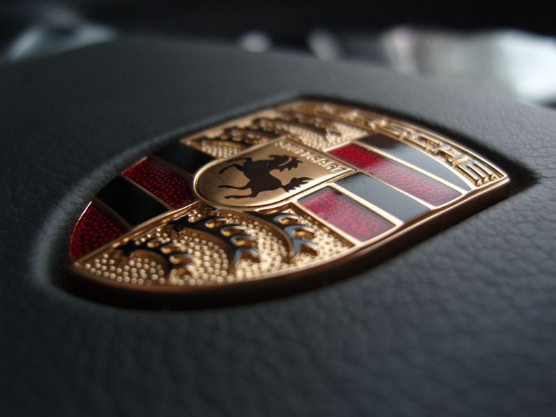 Porsche Logo - Behind the Badge: Revealing the Historic Porsche Crest's Inspiration ...