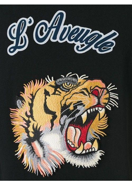12d08670 Gucci Lion Logo - Black cotton lion patch T-shirt from Gucci. | hype
